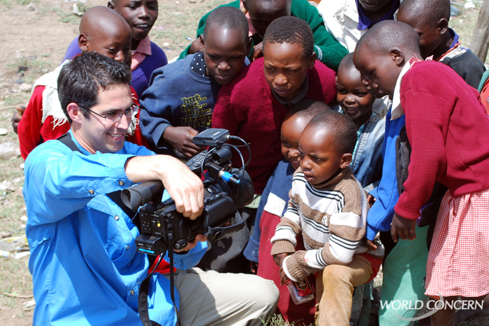 World Concern's Derek Sciba shows boys in Kenya their image on a video camera viewfinder.