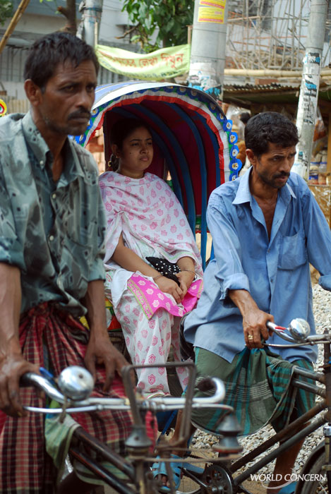 Men muscle 3-wheeled rickshaws through the streets of Dhaka, Bangladesh. The average income for a Bangladeshi: $1,500 a year.