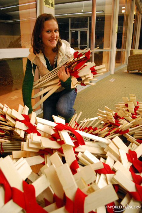 Student Amy Whitley helped with the ribbons, one of several students raising awareness about AIDS.