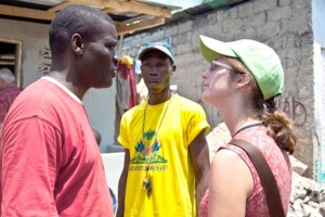Jillian Thorp talks with engineers in Haiti.