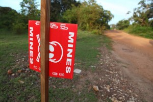 Signs warn of land mines in Sri Lanka.