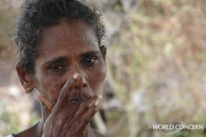 A woman sheds tears in Sri Lanka.