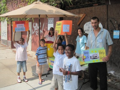 VBS kids sell lemonade.