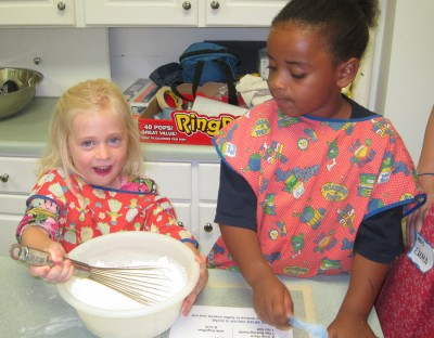 VBS kids baking cookies.