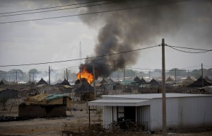 Burning home in Abyei. REUTERS/Stuart Price
