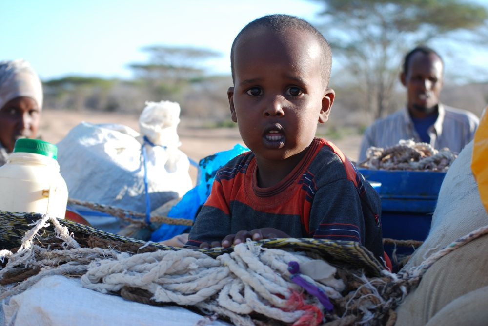 A young boy travels with his family across the Somalia-Kenya border.
