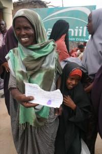 A joyful family receives a food voucher.