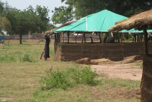 Putting the thatch roof on a new classroom in Kuajok.