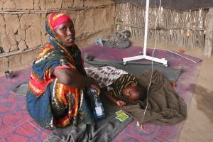 A Somali mom with her sick child.
