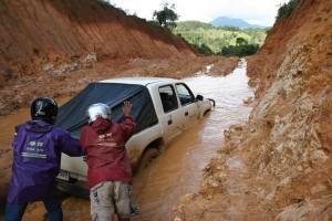 Muddy road to Laotian village.