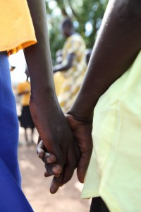 South Sudan kids holding hands.
