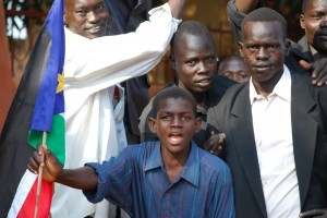 South Sudan boy with flag.