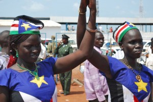 South Sudanese women in flag outfits.