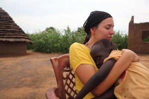 Jenny Simmons holds a child in South Sudan.