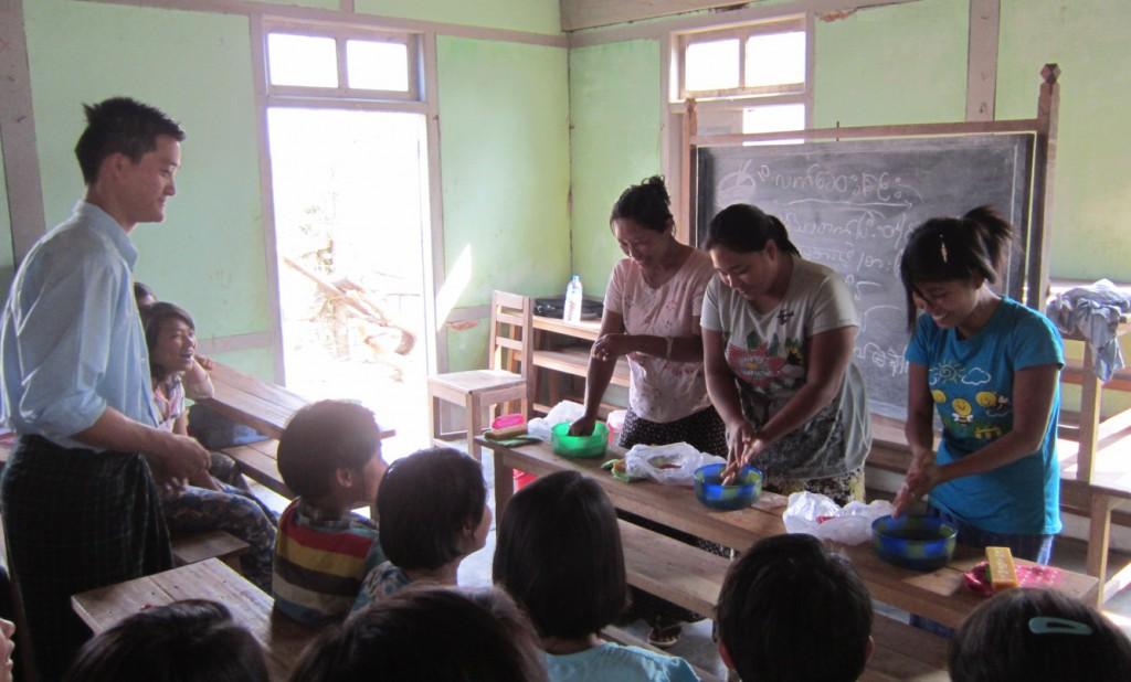 Hand washing training in camp.