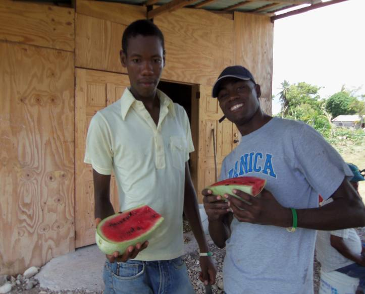 Youth interns at the training center enjoying some watermelon.