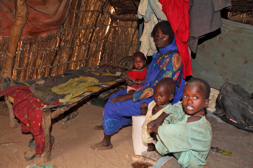 Family inside IDP hut
