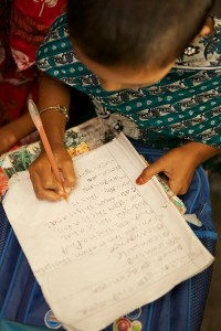 A young girl studying in Bangladesh.