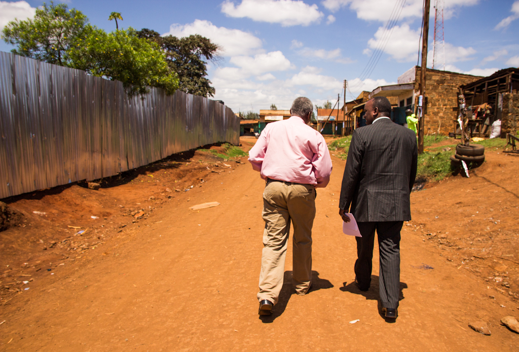 Peter walks with a World Concern beneficiary in Embu, Kenya.
