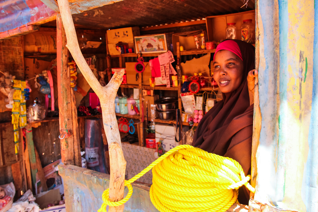 Muna peers out of her small shop in Balanbal.