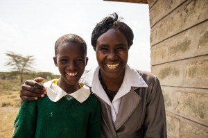Jackline and her teacher, who inspires her to become a teacher one day herself and ensure other girls have the opportunity to go to school.