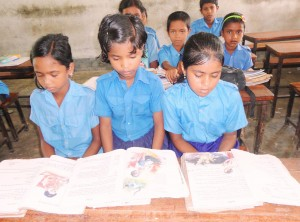 Mitu (right) is now in school, where she belongs, and spending time with her friends.