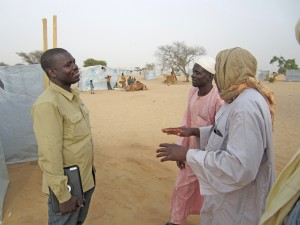 Talking with families at a refugee camp, hearing their stories.