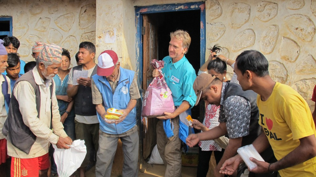 With the help of World Concern donors, Mark Estes, Asia Director, helps distribute emergency food and supplies to victims of the earthquake.