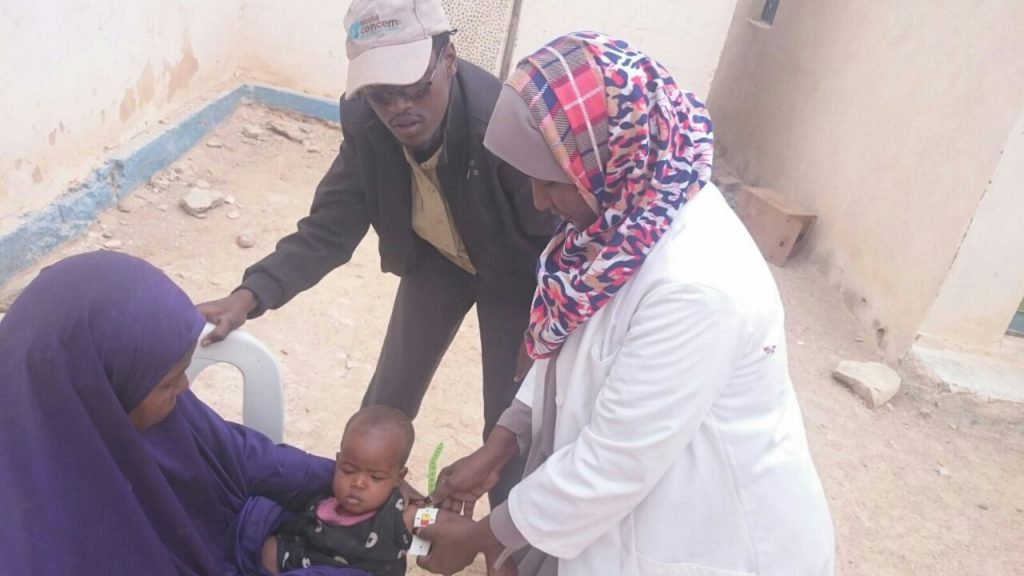 A child in Somalia is measured to check for malnutrition