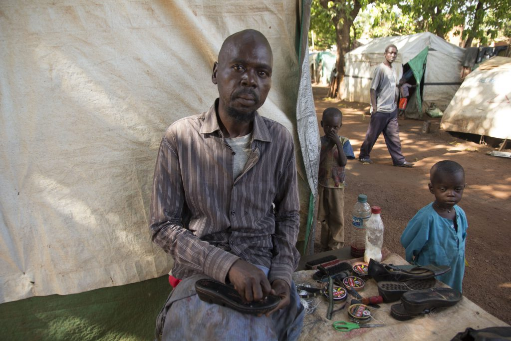 a man works in an internally displaced persons camp in South Sudan