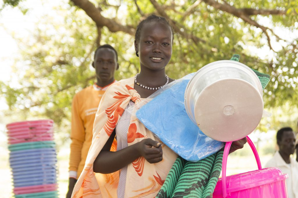 woman in South Sudan receives emergency supplies