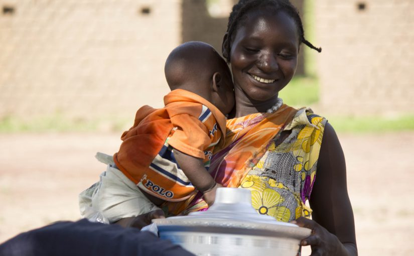 a mom receives emergency supplies in South Sudan