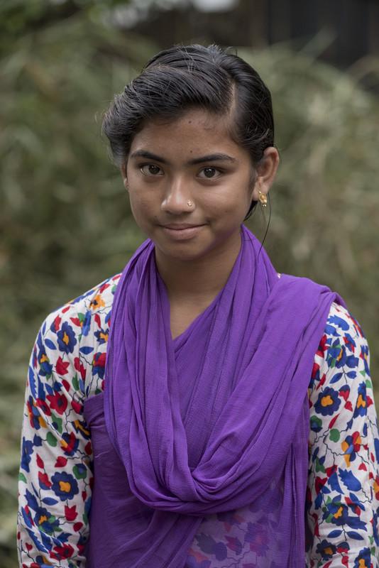 a girl receives an education in Bangladesh