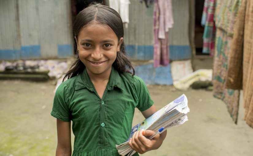 a girl receives an education in Bangladesh