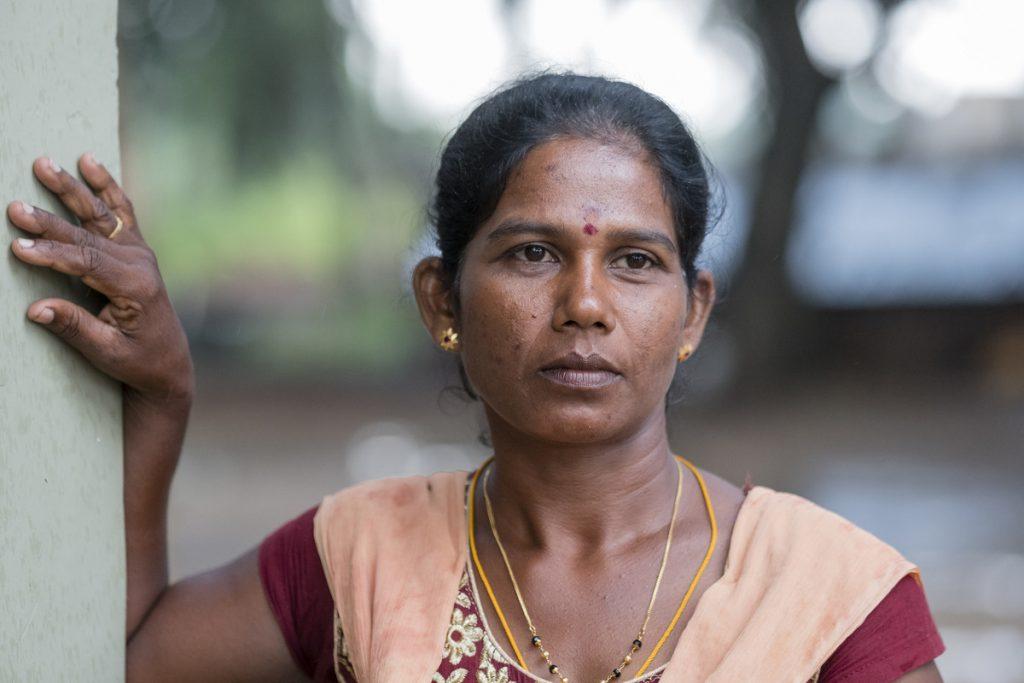 A social worker poses outside a children's shelter in Sri Lanka.