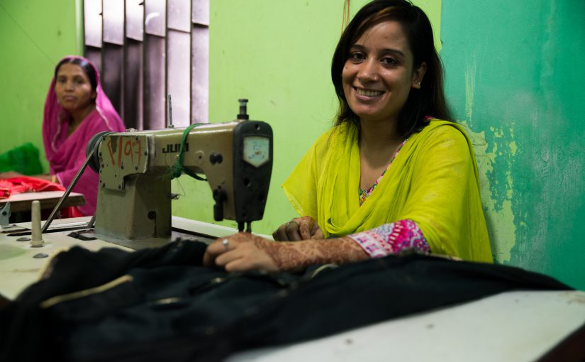 A woman works at a sewing machine in Bangladesh
